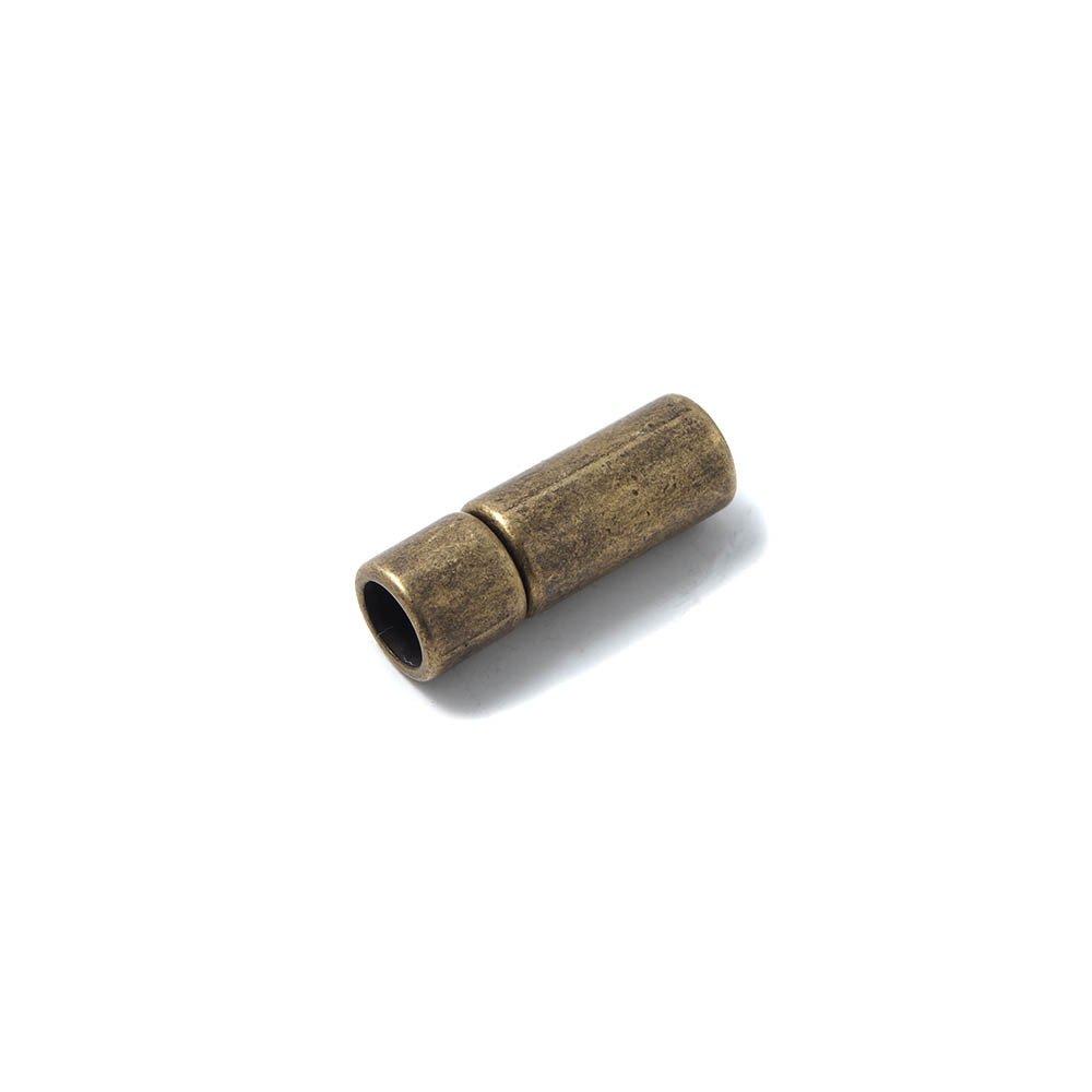 Cierre de presión cilindro, bañado en oro envejecido, con hueco para cuero de 5 mm. de diámetro.