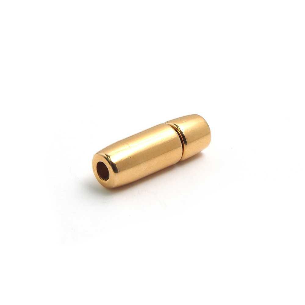 Cierre de presión cilindro, bañado en oro brillante, con hueco para cuero de 3mm. de diámetro.