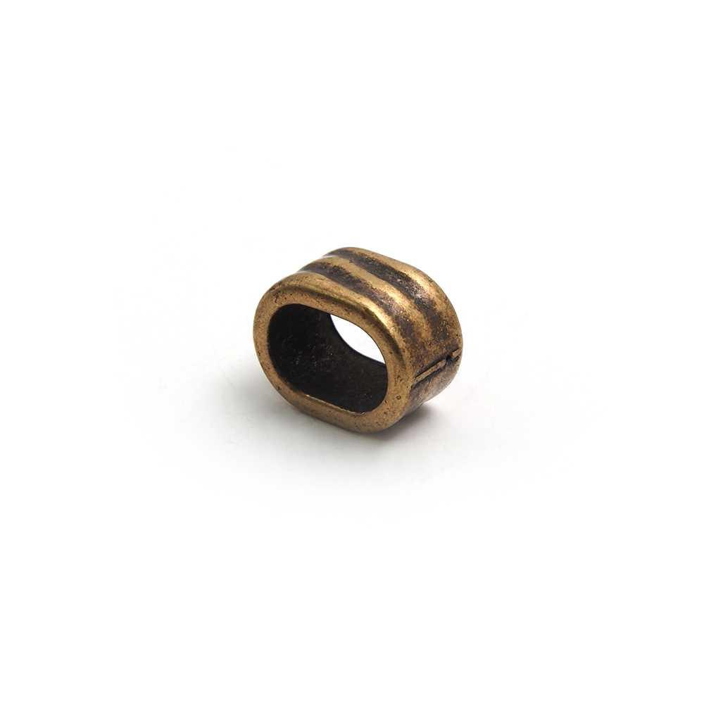 Entrepieza ondas para cuero regaliz (10.5mm x 7mm). Bañada en oro envejecido.
