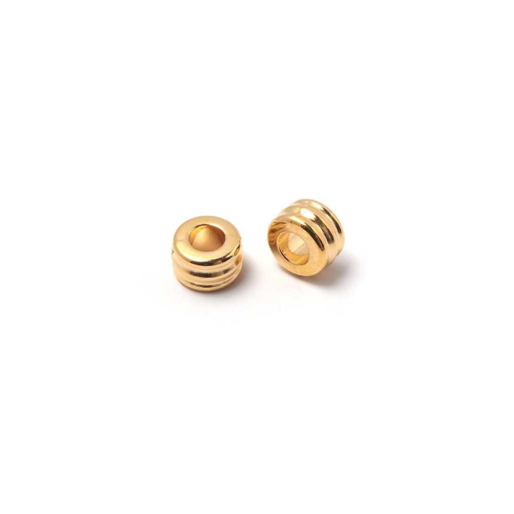Entrepieza ondas para cuero de diámetro 3 mm. Bañada en oro de 24 quilates.