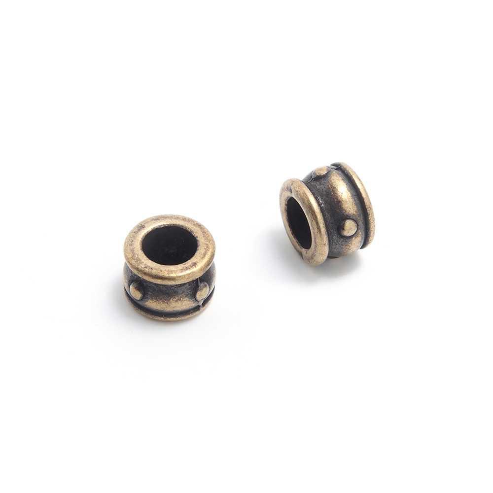 Entrepieza Cupa, para cuero de diámetro 5 mm. Bañada en oro envejecido.