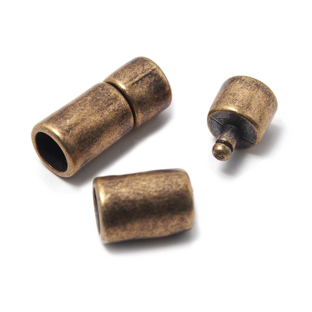 Cierre de presión Cilindro Irregular, para cuero redondo de diámetro 6 mm. Bañado en oro envejecido.