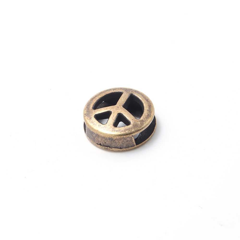 Entrepieza símbolo de la Paz calada, para cuero de 9.5mm x 2.5mm. Bañada en oro envejecido.