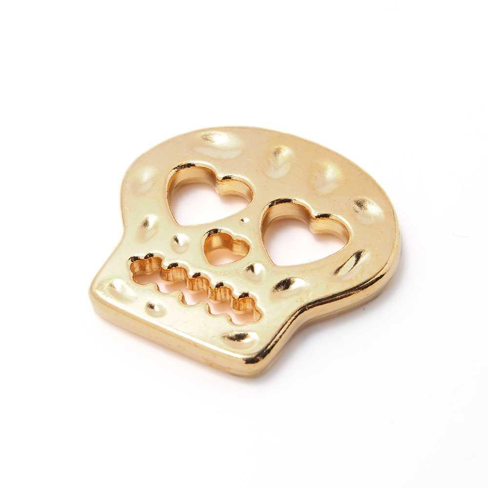 Pieza calavera corazones. Bañada en oro de 24 quilates.