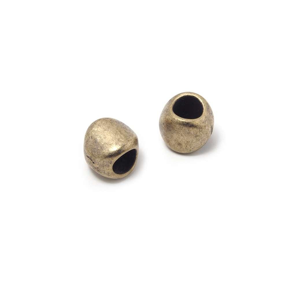Entrepieza Bola Oval, para cuero de diámetro 5 mm. Bañada en Oro envejecido.