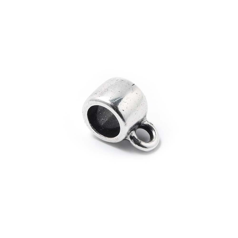 Abalorio Entrepieza redonda con argolla, con hueco para cuero redondo de 5mm. Bañada en plata de ley oxidada.