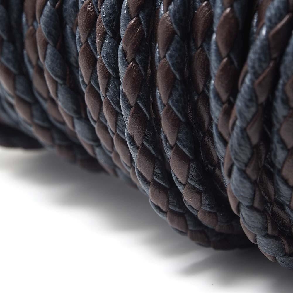 Cuero redondo trenzado de 4mm de grosor. Colores azul y berenjena..