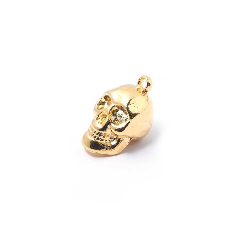 Colgante calavera, con agujero para anilla de 2 mm. Bañado en oro de 24 quilates. Calavera Realista que da mucha fuerza  a tus diseños, la puedes usar de colgante o de charm en una pulsera.