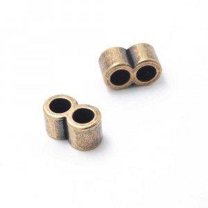 Entrepieza tubo doble, con dos espacios para cuero redondo de diámetro 5mm. Bañada en oro envejecido.