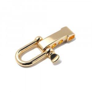 Cierre con forma de grillete recto regulable, bañado en oro de 24 quilates.