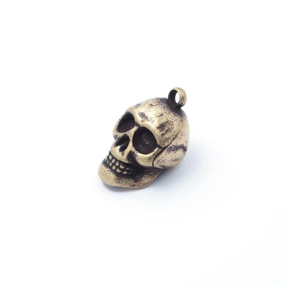 Colgante calavera, anilla 2mm, oro viejo.